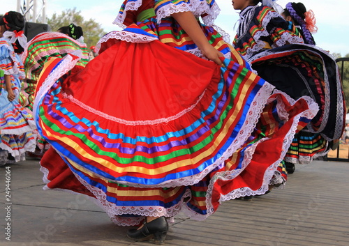 Photo  Colorful skirts fly during Mexican dance