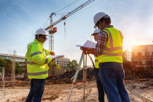 Fotografie, Obraz Construction engineers discussion with architects at construction site or building site of highrise building with Surveying for making contour plans is a graphical representation of the lay in land