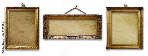 Fototapeta Set of three vintage golden baroque wooden frames on  isolated background