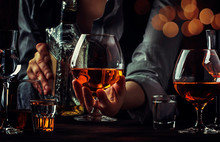 The Bartender Pours The Cognac...