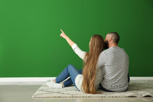 Young Couple Thinking About Design Of Their New Flat