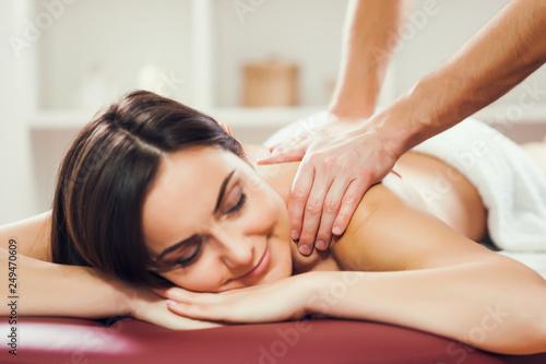 Fotografía  Young woman is enjoying massage on spa treatment.