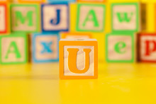 Photograph Of Colorful Wooden Block Letter U
