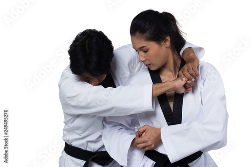 Obrazy Taekwondo   obraz-na-plotnie-two-master-black-belt-taekwondo-handsome-asian-teacher-man-and-caucasian-beautiful-competitor-woman-fighter-show-hit-fighting-pose-self-defense-studio-lighting-white-background-isolated