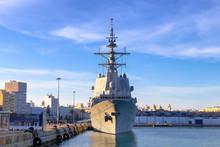 Battleship Moored In The Cadiz Bay Port At Sunset
