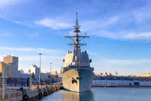 Battleship moored in the Cadiz bay port at sunset Wallpaper Mural