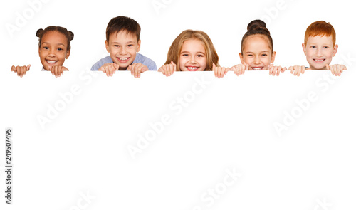 Photo  Children with empty board isolated on white