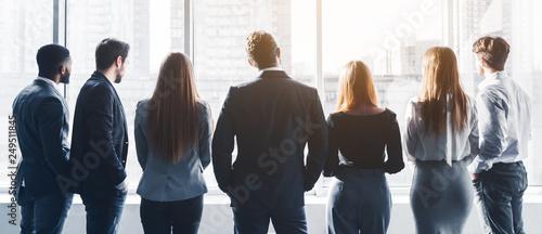 Business team having break at meeting, back view