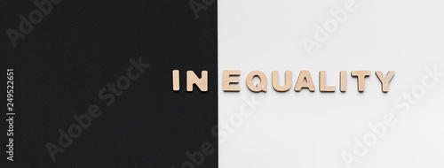Fotografía  Word Inequality written on black and white background