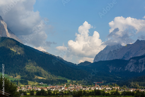 Staande foto Nepal Idyllic landscape in the Alps with fresh green meadows, blooming flowers, typical farmhouses and snowcapped mountain tops in the background, Nationalpark Berchtesgadener Land, Bavaria, Germany