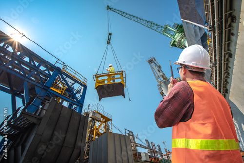 engineering, loading master connecting to gantry crane driver by walkie talkie f Wallpaper Mural