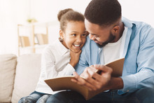 African-american Dad And Daughter Spending Time, Reading Book