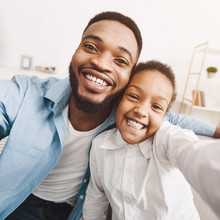 African-american Father Taking...
