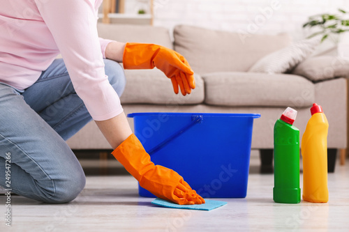 Woman with obsessive compulsive disorder cleaning floor Fototapet