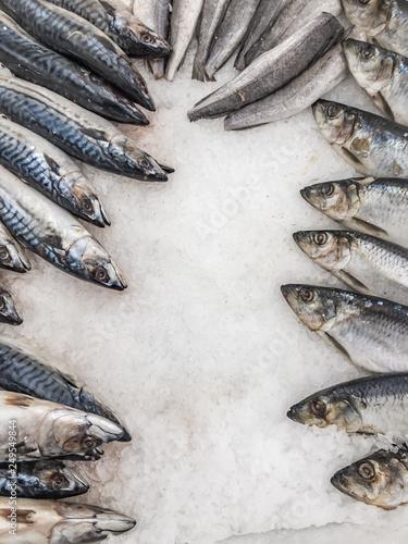 Fotografie, Obraz  fresh and rotten, dangerous food, stale fish for sale on the market frame