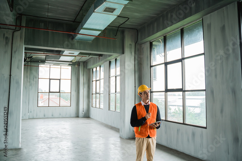 young asian engineer doing inspection on project installation Canvas Print