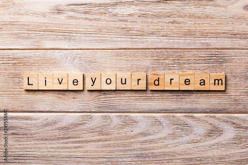Fotografie, Obraz  live your dream word written on wood block