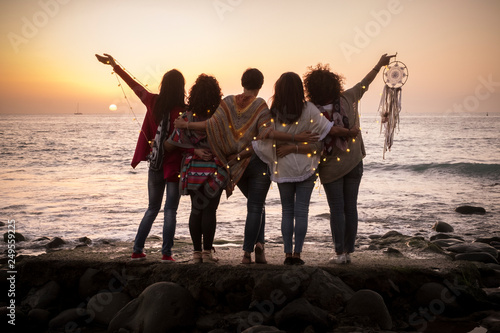 Fototapeta Dreaming image with group of females friends hug each other all together looking
