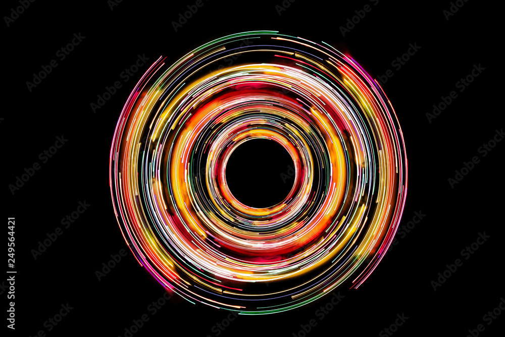 Fototapety, obrazy: Abstract neon circle lines with empty copy space inside isolated on black background. Colorful led lights long exposure rotation photo.