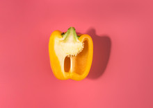 Natural Organic Yellow Sliced Bulgarian Bell Pepper On Trend Pink Background.Top View.Healthy Food Concept. Flat Lay.Copy Space. Minimalism Style.Vegetables Vitamins Rustic Style.
