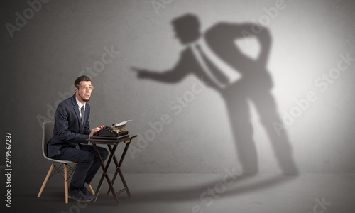 Fototapety, obrazy: Little man working and a big shadow arguing with him