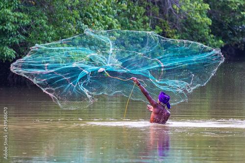 Obraz na plátně Fisherman fishing with net. Sri Lanka.