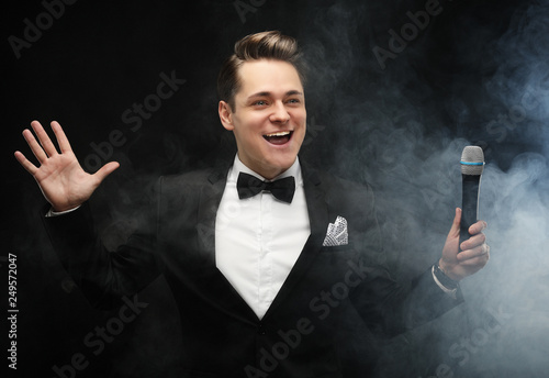 Young handsome man with microphone Wallpaper Mural