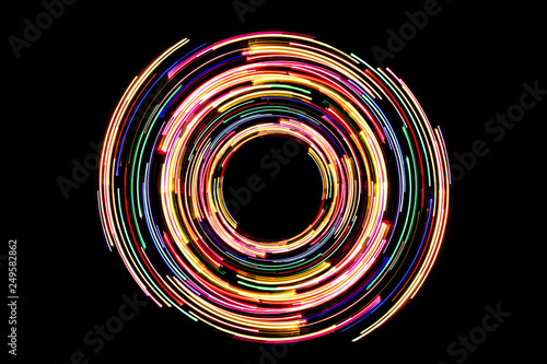 Abstract neon circle lines with empty copy space inside isolated on black background Tableau sur Toile