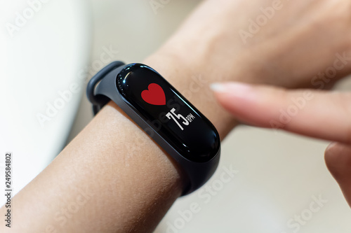 Valokuva  Close up image hand of male using smart watch with health app checking measure h