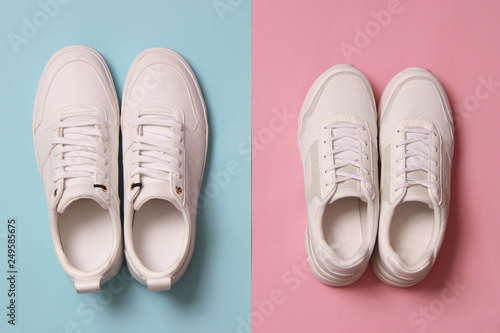 Fotografia  Men's and women's sneakers on a colored background top view