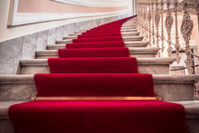 Spiral Stairways Covered With A Red Carpet