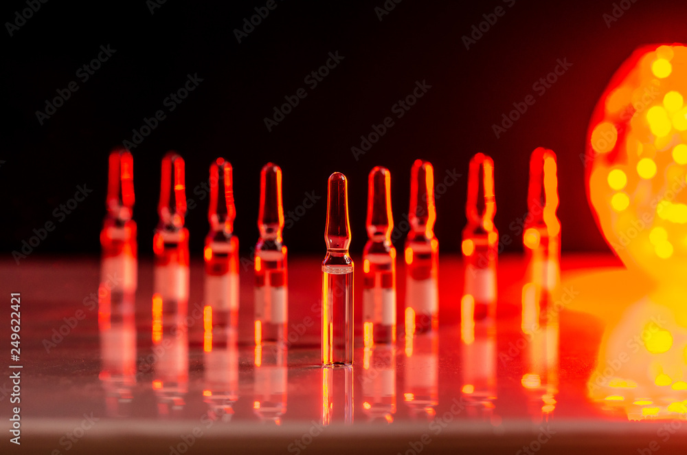 Photo & Art Print ampoules made of glass standing on the