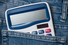 Closeup Of Calculator In Blue Jeans Pocket