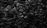Fototapeta Kamienie - Natural fire ashes with dark grey black coals texture. It is a flammable black hard rock.  Space for text.