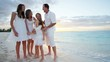 Caucasian family on a beach at sunset