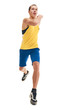 Young athletic guy in sportswear running on white background