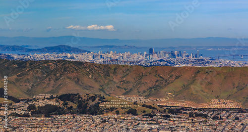 Foto auf Gartenposter Cappuccino Aerial view of downtown San Francisco and Financial District sky scrapers flying over South San Francisco The Industrial City inscription on San Bruno mountain circa 2015