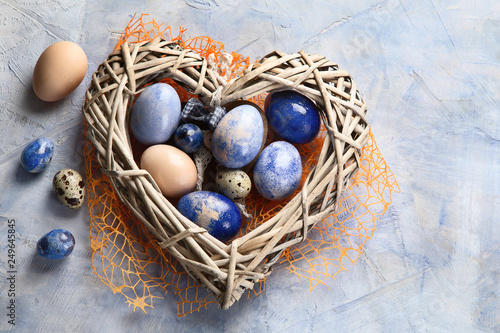 Fototapeta Easter eggs in heart shaped nest obraz