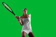 Girl tennis player on green background.