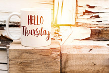 Text HELLO Thursday On Cup Of Aromatic Coffee On Wooden Cube