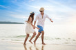 Romantic couple relaxing on the beach and enjoying beautiful sea view