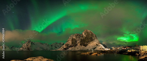 Montage in der Fensternische Nordlicht Aurora borealis dancing on mountain in fishing village at Reine and Sakrisoy, Lofoten, Norway Visiting the Lofoten Islands during winter time is a dream for all landscape photographers Christmas time