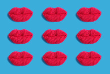 Knitted Pink Lips On A Blue Ba...