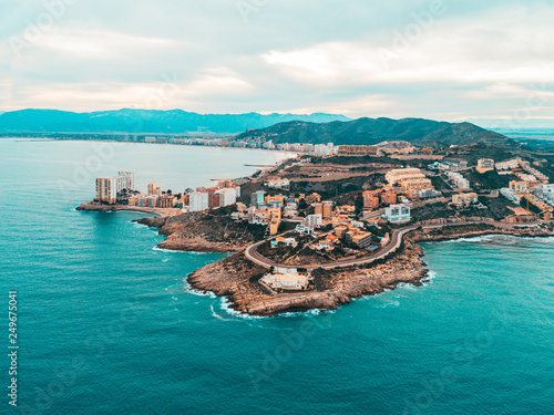 Montage in der Fensternische Südeuropa Beautiful mediterranian coastline near Valencia, Spain with small town, hotels, buildings and roads. Autumn winter blue turquoise cold sea water and warm colors coastline. Aerial drone shot view