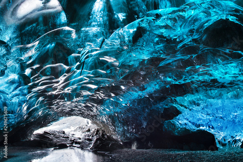 Blue crystal ice cave and an underground river beneath the glacier Fototapet