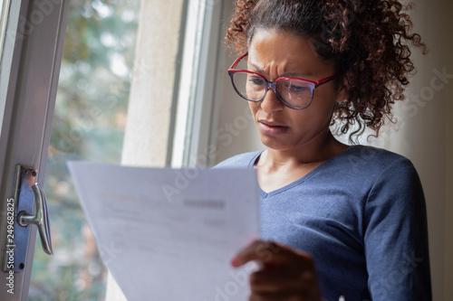 Portrait of worried black woman standing beside window Fototapet