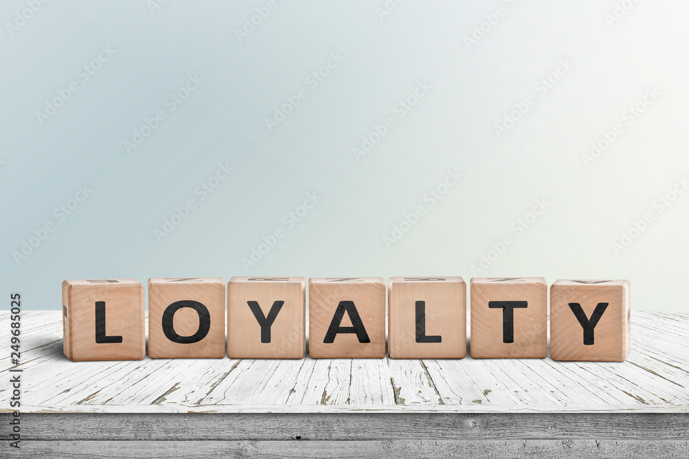 Fototapeta Loyalty sign on a wooden table in bright daylight