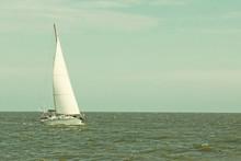 Lonely Sailboat Yacht At Sea.