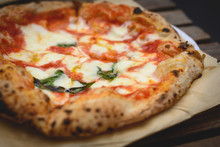 Close Up View Of A Margherita Neapolitan Style Pizza With Buffalo Mozzarella, Tomato Sauce And Basil. Landscape Format.