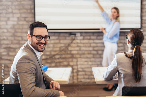 Fotomural Confident speaker giving public presentation using projector in conference room